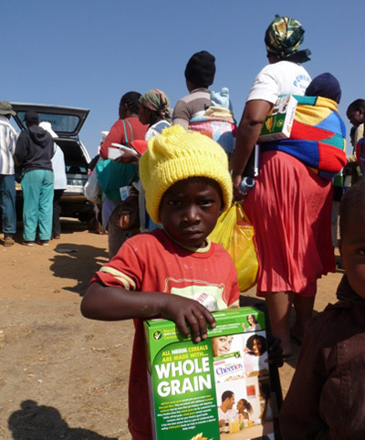 A little boy who survives with his family on the municipal dump in Johannesburg, with cereal supplied by Oliver Quambusch of Hotel Hope.